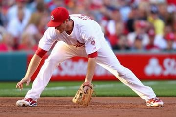 ST. LOUIS, MO - JUNE 12: David Freese #23 of the St. Louis Cardinals fails to field a line drive against the Chicago White Sox at Busch Stadium on June 12, 2012 in St. Louis, Missouri.  (Photo by Dilip Vishwanat/Getty Images) By Dilip Vishwanat