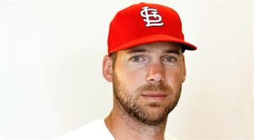 JUPITER, FL - FEBRUARY 29:  Chris Carpenter #29 of the St. Louis Cardinals poses during photo day at Roger Dean Stadium on February 29, 2012 in Jupiter, Florida.  (Photo by Mike Ehrmann/Getty Images) By Mike Ehrmann