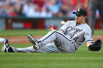 ST. LOUIS, MO - JUNE 13: Starter Jake Peavy #44 of the Chicago White Sox bobbles a ground ball against the St. Louis Cardinals at Busch Stadium on June 13, 2012 in St. Louis, Missouri.  (Photo by Dilip Vishwanat/Getty Images) By Dilip Vishwanat