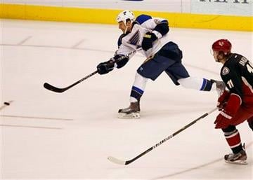St. Louis Blues' Chris Stewart, left, shoot on goal as Phoenix Coyotes' Martin Hanzal looks on during the first period of an NHL hockey game, Friday, Dec. 23, 2011, in Glendale, Ariz.  (AP Photo/Matt York) By Matt York