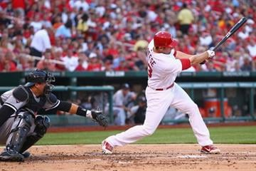 ST. LOUIS, MO - JUNE 14: David Freese #23 of the St. Louis Cardinals hits an RBI double against the Chicago White Sox at Busch Stadium on June 14, 2012 in St. Louis, Missouri.  (Photo by Dilip Vishwanat/Getty Images) By Dilip Vishwanat