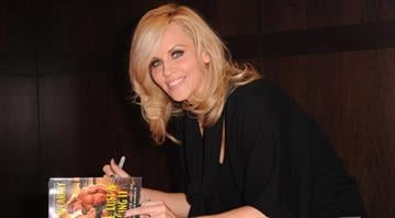 """Author Jenny McCarthy signs copies of her new book """"Love, Lust & Faking It"""" at Barnes and Noble bookstore on October 4, 2010 in Los Angeles, California.  (Photo by Alberto E. Rodriguez/Getty Images) By Alberto E. Rodriguez"""