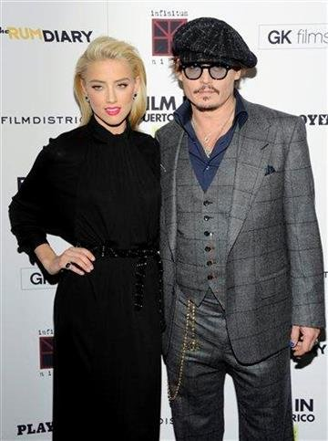 """Actors Amber Heard and Johnny Depp attend the premiere of """"The Rum Diary"""" at the Museum of Modern Art on Tuesday, Oct. 25, 2011 in New York. (AP Photo/Evan Agostini) By Evan Agostini"""