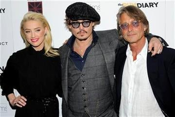 "Actors Amber Heard, left, and Johnny Depp, center, pose with director Bruce Robinson at the premiere of ""The Rum Diary"" at the Museum of Modern Art on Tuesday, Oct. 25, 2011 in New York. (AP Photo/Evan Agostini) By Evan Agostini"