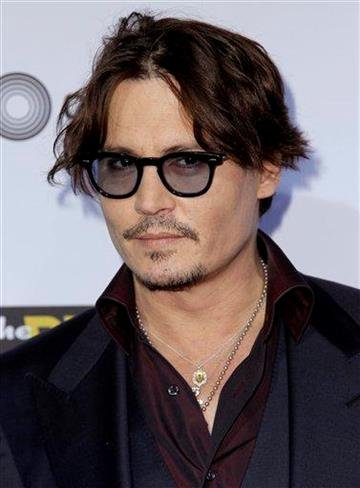 "Cast member Johnny Depp arrives at the premiere of ""The Rum Diary"" in Los Angeles, Thursday, Oct. 13, 2011.  ""The Rum Diary"" opens in theaters Oct. 28, 2011. (AP Photo/Matt Sayles) By Matt Sayles"