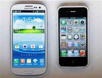 This June 19, 2012 photo shows Samsung?s new Galaxy S III phone, left, next to an iPhone 4S in New York. The Galaxy S III, which looks and feels like an oversized iPhone, is available next week. (AP Photo/Bebeto Matthews) By Bebeto Matthews