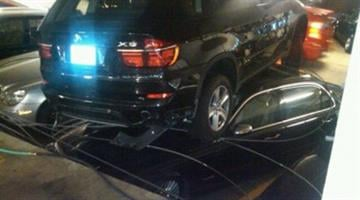 A man was driving a rented BMW SUV in a parking garage in downtown Chicago Thursday when he drove over a guard rail and landed on top on two other luxury cars. By Belo Content KMOV