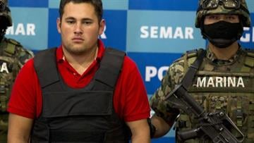 A man presented by authorities as Alfredo Guzman Salazar is shown to the media in Mexico City, Thursday, June 21, 2012. As it turns out, the man is really Felix Beltran Leon, 23. (AP Photo/Eduardo Verdugo) By Dan Mueller