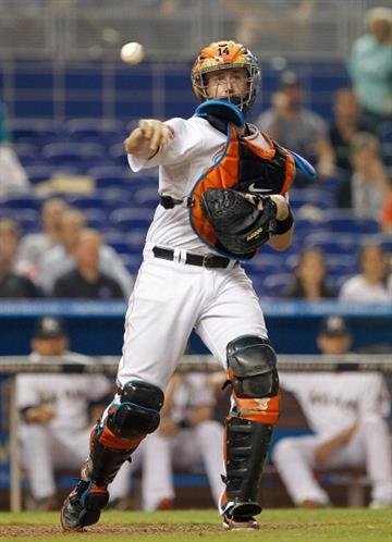 MIAMI, FL - JUNE 25: John Buck #14 of the Miami Marlins makes a throw to first during a game against the St. Louis Cardinals at Marlins Park on June 25, 2012 in Miami, Florida.  (Photo by Mike Ehrmann/Getty Images) By Mike Ehrmann