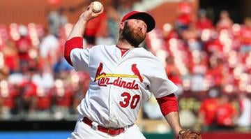 ST. LOUIS, MO - JUNE 16: Reliever Jason Motte #30 of the St. Louis Cardinals pitches against the Kansas City Royals at Busch Stadium on June 16, 2012 in St. Louis, Missouri. (Photo by Dilip Vishwanat/Getty Images) By Dan Mueller
