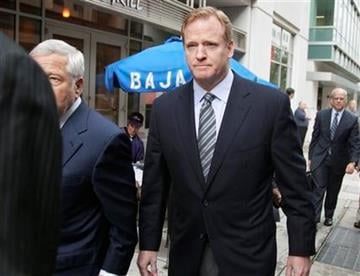 NFL football Commissioner Roger Goodell, right, New England Patriots owner Robert Kraft, and others, arrives at the NFL Players Association in Washington, Monday, July 25, 2011. (AP Photo/Carolyn Kaster) By Carolyn Kaster