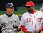 Milwaukee Brewers manager Ron Roenicke (10) talks with Cincinnati Reds manager Dusty Baker (12) prior to their opening day baseball game, Thursday, March 31, 2011, in Cincinnati. (AP Photo/Al Behrman) By Al Behrman