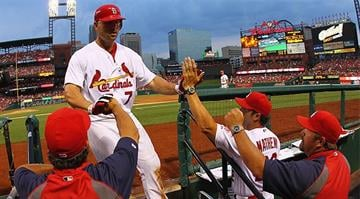 ST. LOUIS, MO - JULY 2: Matt Holliday #7 of the St. Louis Cardinals is congratulated by teammates after hitting a solo home run against the Colorado Rockies at Busch Stadium on July 2, 2012 in St. Louis, Missouri. (Photo by Dilip Vishwanat/Getty Images)