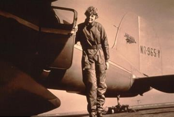 125345 13: Photo of pilot Amelia Earhart standing by her plane. (Photo by Getty Images) By Getty Images