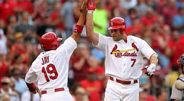 St. Louis Cardinals Matt Holliday (R) celebrates his two run home run with teammate John Jay as he crosses homeplate in the first inning against the Colorado Rockies at Busch Stadium in St. Louis on July 3, 2012.    UPI/Bill Greenblatt