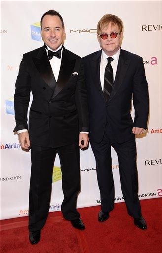 David Furnish, left, and Elton John attend the Elton John AIDS Foundation 10th Annual Enduring Vision Benefit, on Wednesday, Oct. 26, 2011, in New York. (AP Photo/Peter Kramer) By Peter Kramer