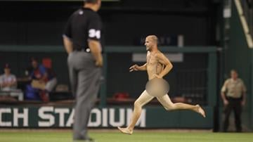 A streaker runs on the field past umpire Sam Holbrook during the seventh inning of a game between the Philadelphia Phillies and the St. Louis Cardinals at Busch Stadium in St. Louis on May 24, 2012. UPI/Bill Greenblatt By Eric Lorenz