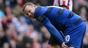 Manchester United's English striker Wayne Rooney reacts the English Premier League football match between Sunderland and Manchester United at The Stadium of Light in Sunderland, north-east England on May 13, 2012. ANDREW YATES/AFP/GettyImages)