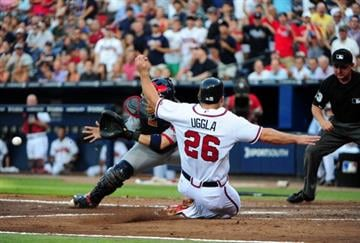 ATLANTA, GA - MAY 30: Dan Uggla #26 of the Atlanta Braves slides in to score against Yadier Molina #4 of the St. Louis Cardinals at Turner Field on May 30, 2012 in Atlanta, Georgia. (Photo by Scott Cunningham/Getty Images) By Scott Cunningham