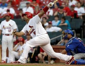 St. Louis Cardinals' Albert Pujols hits a walkoff home run in the 12th inning of a baseball game to defeat the Chicago Cubs 5-4 Saturday, June 4, 2011, in St. Louis. (AP Photo/Jeff Roberson) By Jeff Roberson