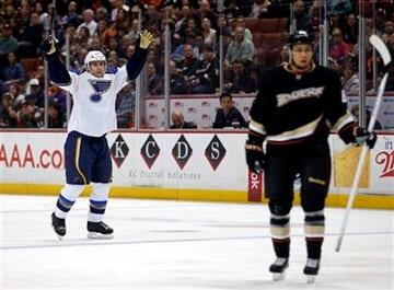 St. Louis Blues' Wade Redden, left, celebrates a goal by teammate Ryan Reaves,  as Anaheim Ducks' Ben Lovejoy looks on during the first period of an NHL hockey game in Anaheim, Calif., Sunday, March 10, 2013. (AP Photo/Jae C. Hong) By Jae C. Hong