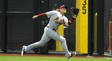 PHOENIX, AZ - APRIL 03:  Allen Craig #21 of the St Louis Cardinals makes a running catch in the first inning against the Arizona Diamondbacks at Chase Field on April 3, 2013 in Phoenix, Arizona.  (Photo by Norm Hall/Getty Images) By Norm Hall