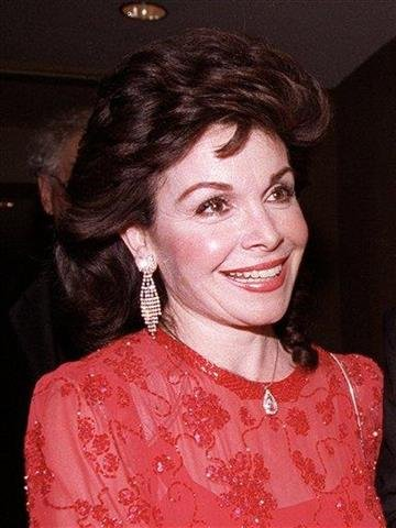 FILE - In this Oct. 20, 1990 file photo, actress and former Mickey Mouse Club member Annette Funicello arrives for the 15th annual Italian American Foundation dinner in Washington, D.C.  (AP Photo/J. Scott Applewhite, file) By J. SCOTT APPLEWHITE