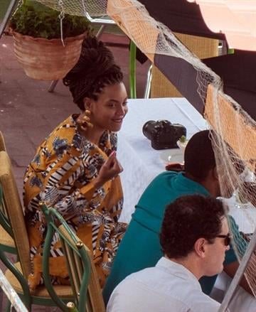 US singer Beyonce is seen in a private restaurant in Havana, next to her husband Jay Z (green shirt), on April 4, 2013.     AFP PHOTO/STR        (Photo credit should read STR/AFP/Getty Images) By STR