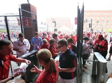 ST. LOUIS, MO - APRIL 08:  Fans enter the staduim before the Opening Day game between the St. Louis Cardinals and the Cincinnati Reds on April 8, 2013 at Busch Stadium in St. Louis, Missouri.  (Photo by Elsa/Getty Images) By Elsa