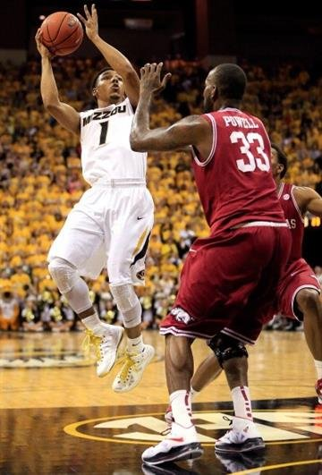COLUMBIA, MO - MARCH 05:  Phil Pressey #1 of the Missouri Tigers shoots over Marshawn Powell #33 of the Arkansas Razorbacks during the game at Mizzou Arena on March 5, 2013 in Columbia, Missouri.  (Photo by Jamie Squire/Getty Images) By Jamie Squire