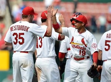 ST. LOUIS, MO - APRIL 10: Jon Jay #19 of the St. Louis Cardinals high fives Jake Westbrook #35 after defeating the Cincinnati Reds at Busch Stadium on April 10, 2013 in St. Louis, Missouri.  (Photo by Jeff Curry/Getty Images) By Jeff Curry
