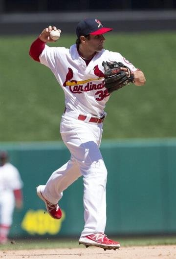 ST. LOUIS, MO - APRIL 14: Pete Kozma #38 of the St. Louis Cardinals throws to first base during the game against the Milwaukee Brewers at Busch Stadium on April 14, 2013 in St. Louis, Missouri. (Photo by David Welker/Getty Images) By David Welker
