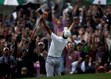 Adam Scott, of Australia, celebrates after making a birdie putt on the second playoff hole to win the Masters golf tournament Sunday, April 14, 2013, in Augusta, Ga. (AP Photo/Matt Slocum) By Matt Slocum