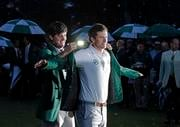 Bubba Watson, left, helps Adam Scott, of Australia, put on his green jacket after winning the Masters golf tournament Sunday, April 14, 2013, in Augusta, Ga. (AP Photo/Charlie Riedel) By Charlie Riedel