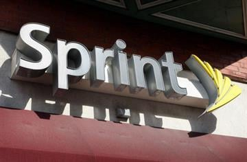 CHICAGO - FEBRUARY 28:  The Sprint Nextel logo hangs above a Sprint retail store February 28, 2008 in Chicago Illinois. Sprint said it lost $29.5 billion during the quarter ending Dec. 31.  (Photo by Scott Olson/Getty Images) By Scott Olson