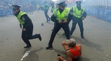 Police react to a runner who was knocked down after the second explosion near the finish line of the 2013 Boston Marathon. By Brendan Marks
