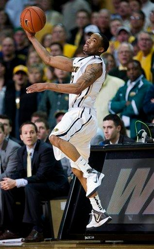 Missouri's Marcus Denmon saves a ball from going out-of-bounds during the second half of an NCAA college basketball game against Baylor Saturday, Feb. 11, 2012, in Columbia, Mo. Missouri won the game 72-57. (AP Photo/L.G. Patterson) By L.G. PATTERSON