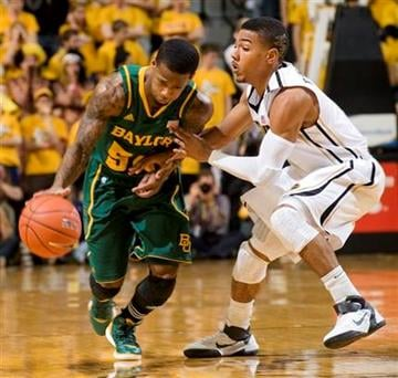Baylor's Pierre Jackson, left, forces his way around Missouri's Phil Pressey, right, during the first half of an NCAA college basketball game Saturday, Feb. 11, 2012, in Columbia, Mo. (AP Photo/L.G. Patterson) By L.G. PATTERSON
