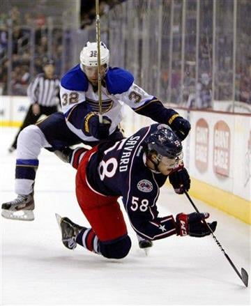 St. Louis Blues' Chris Porter (32) knocks Columbus Blue Jackets' David Savard (58) to the ice during the first period of an NHL hockey game, Tuesday, Feb. 14, 2012, in Columbus, Ohio. (AP Photo/Terry Gilliam) By Terry Gilliam