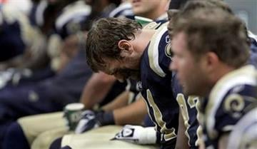 St. Louis Rams defensive end Chris Long hangs his head during the fourth quarter of an NFL football game against the San Francisco 49ers Sunday, Jan. 1, 2012, in St. Louis. The 49ers won 34-27. (AP Photo/Seth Perlman) By Seth Perlman