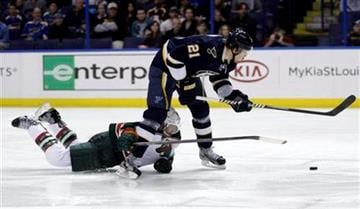 Minnesota Wild's Greg Zanon (5) trips St. Louis Blues' Patrik Berglund (21) while on a a breakaway, drawing a penalty shot, in the second period of an NHL hockey game, Saturday, Feb. 18, 2012 in St. Louis. (AP Photo/Tom Gannam) By Tom Gannam