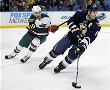 St. Louis Blues' Barret Jackman (5) skates with the puck as Minnesota Wild's Devin Setoguchi (10) pursues during the first period of an NHL hockey game, Saturday, Feb. 18, 2012 in St. Louis.(AP Photo/Tom Gannam) By Tom Gannam