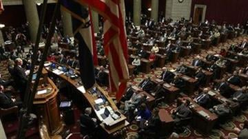 Missouri Gov. Jay Nixon, left, delivers the annual State of the State address to a joint session of the House and Senate Tuesday, Jan. 17, 2012, at the capitol in Jefferson City, Mo. (AP Photo/Jeff Roberson) By AP