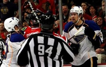 St. Louis Blues' Patrik Berglund, right, mixes it up with Chicago Blackhawks' Jonathan Toews (19) during the first period of an NHL hockey game on Sunday, Feb. 19,  2012, in Chicago. (AP Photo/John Smierciak) By John Smierciak