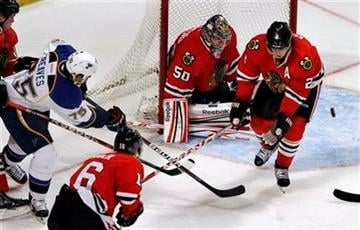 Chicago Blackhawks goalie Corey Crawford stops a shot by St. Louis Blues' Ryan Reaves during the second period of an NHL hockey game Sunday, Feb. 19, 2012, in Chicago. Chicago won 3-1. (AP Photo/John Smierciak) By John Smierciak