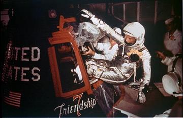 Astronaut John Glenn, Jr. is loaded into the Friendship 7 capsule in preparation for flight on the Mercury Titan rocket February 20, 1962 By NASA