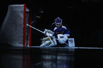 ST. LOUIS, MO - NOVEMBER 4:  Brian Elliott #1 of the St. Louis Blues stretches prior to playing against the Vancouver Canucks at the Scottrade Center on November 4, 2011 in St. Louis, Missouri.  (Photo by Dilip Vishwanat/Getty Images) By Dilip Vishwanat