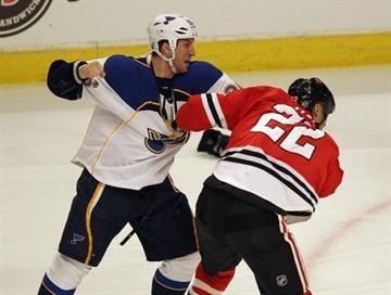 CHICAGO, IL - MARCH 13: B.J. Crombeen #26 of the St. Louis Blues fights with Jamal Mayers #22 of the Chicago Blackhawks at the United Center on March 13, 2012 in Chicago, Illinois.  (Photo by Jonathan Daniel/Getty Images) By Jonathan Daniel
