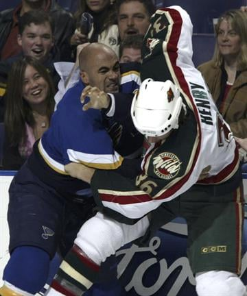 ST. LOUIS - OCTOBER 22:  Jamal Mayers #21 of the St. Louis Blues fights Alex Henry #36 of the Minnesota Wild during the first period at Savvis Center on October 22, 2005 in St. Louis, Missouri.  (Photo by Dilip Vishwanat/Getty Images) By Dilip Vishwanat
