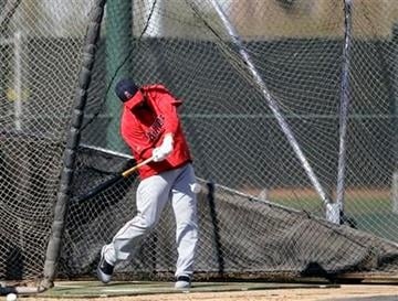 Los Angeles Angels' Albert Pujols hits balls in a batting cage during a baseball spring training workout Monday, Feb. 20, 2012, in Tempe, Ariz. (AP Photo/Morry Gash) By Morry Gash